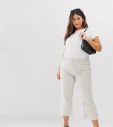 Vaqueros Capri acampanados en pana tono arcilla con diseño a cuadros E...