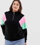 Sudadera con cremallera en el cuello y diseño colour block de ASOS DES...