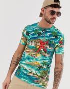 Camiseta con estampado hawaiano, bolsillo y logo de jugador en azul de...